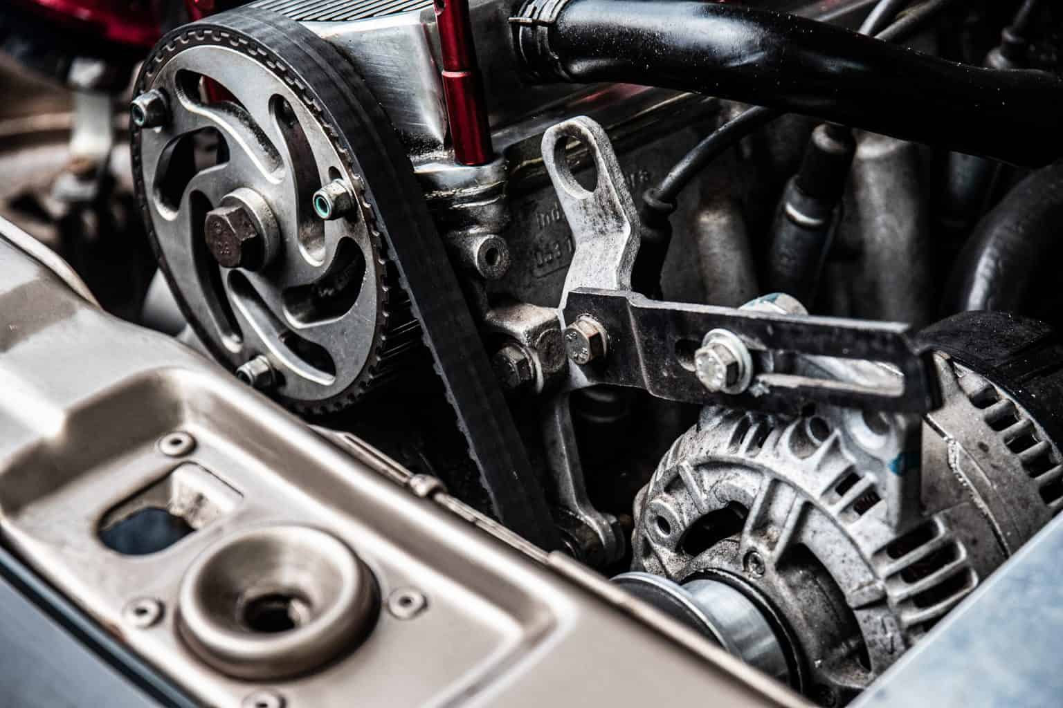 A shot of a car engine with several racks