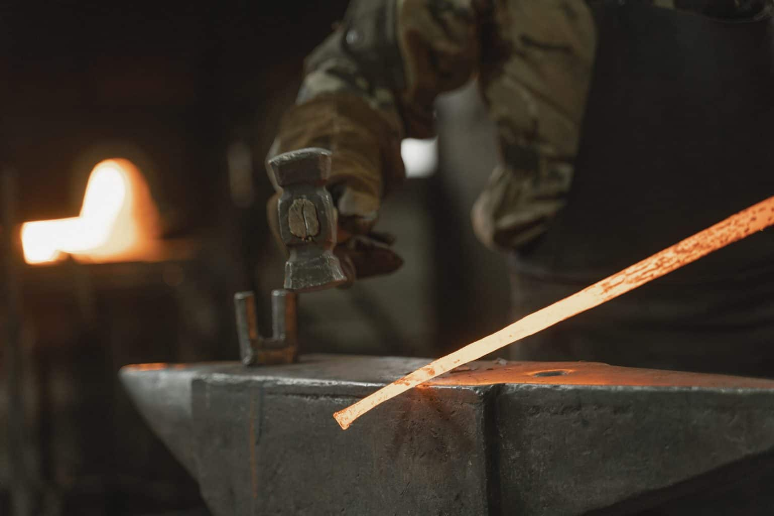 Hammering a forged steel