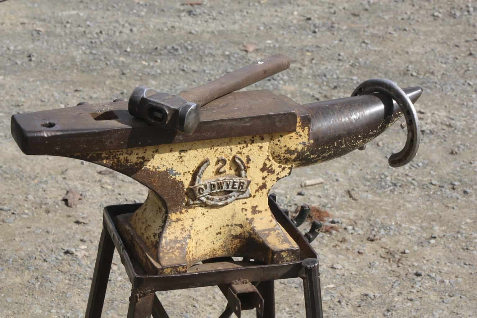 An old anvil with an hammer on top
