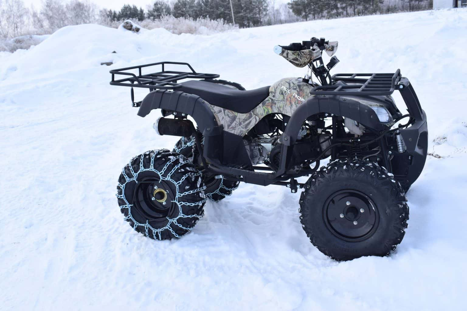 A shot of an ATV in snow
