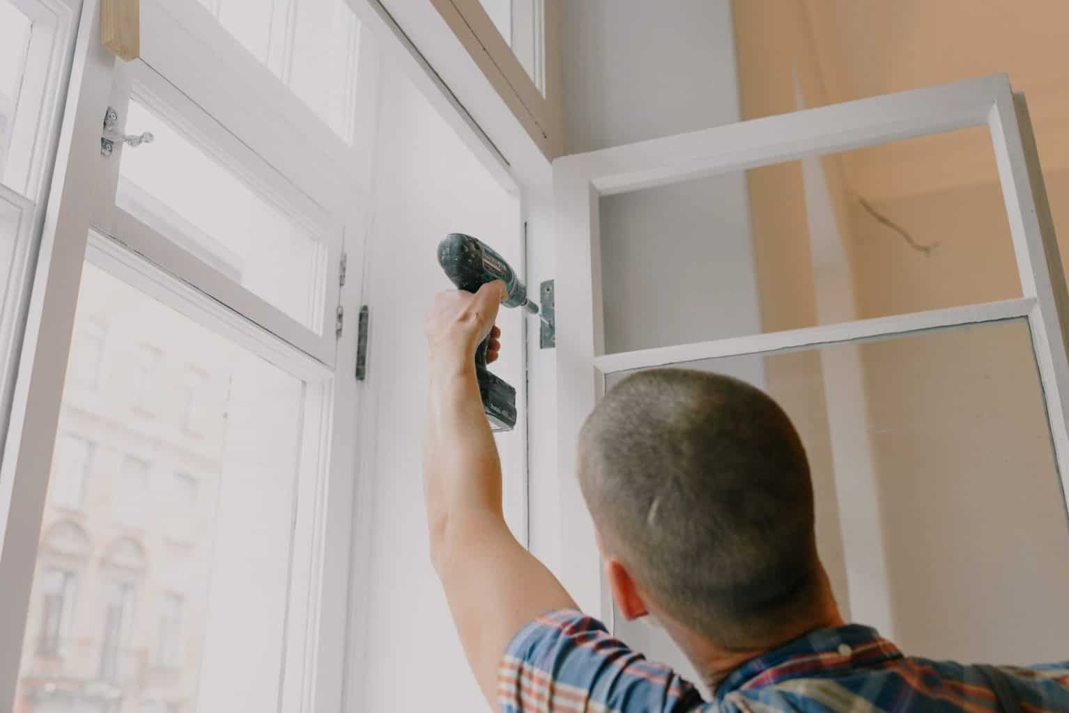 A man drilling with a door screw