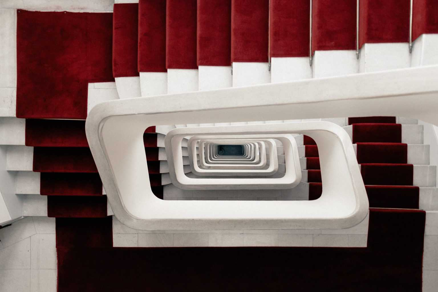 Deep stairs with a red carpet