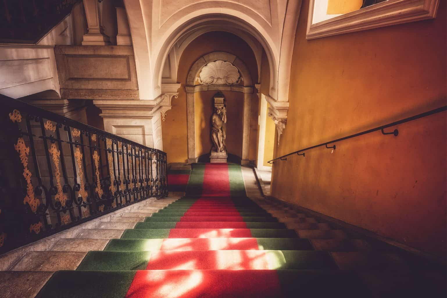 Stairs with red and green tone carpet