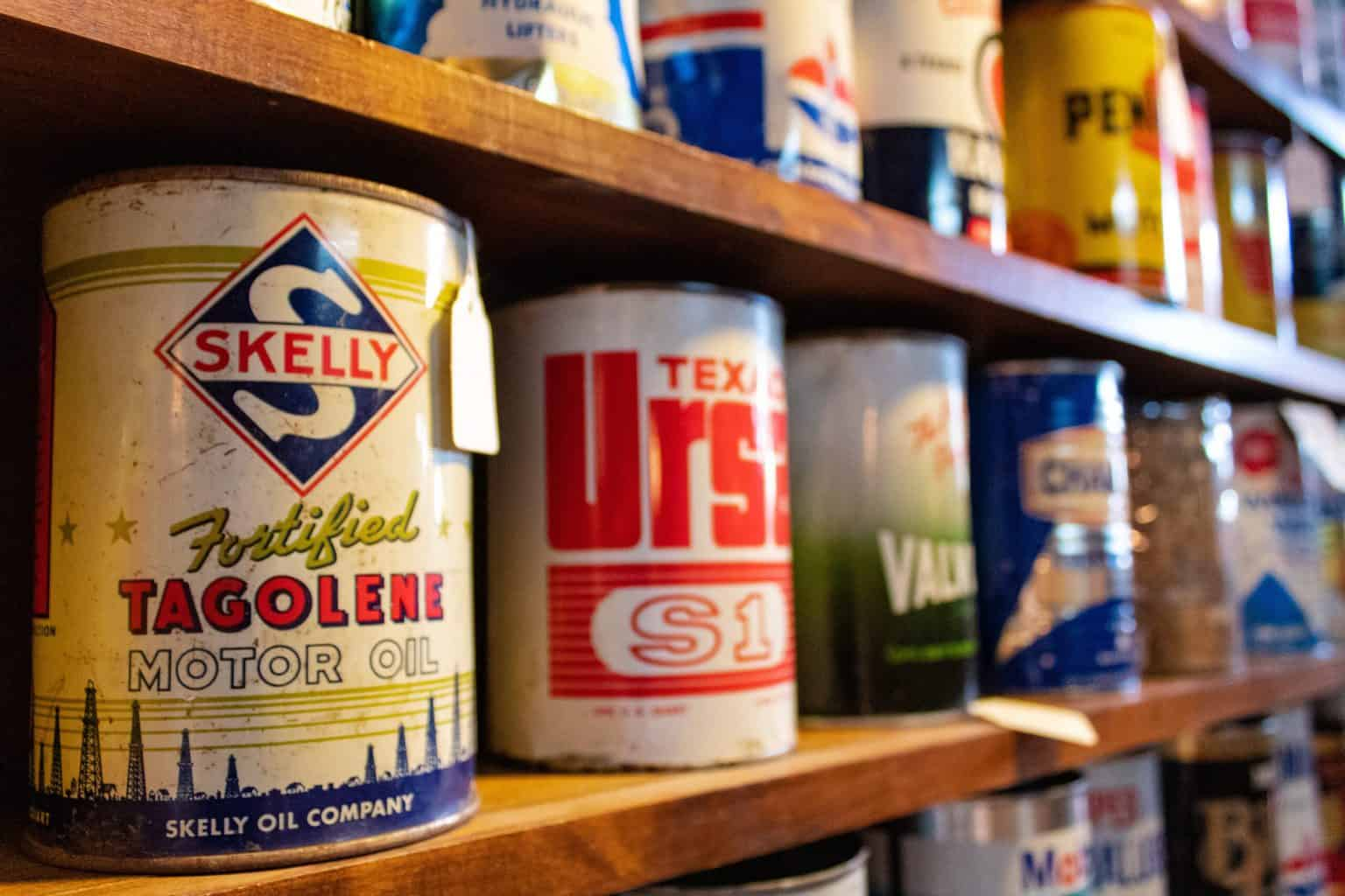 Oil cans stacked on a shelf