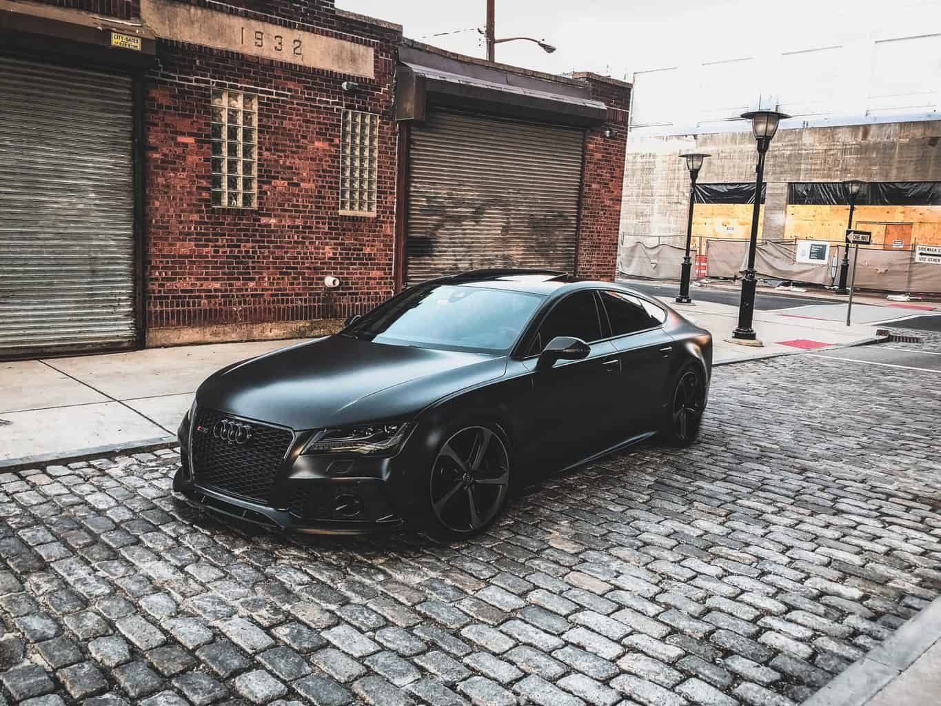 A side view of a black toned car