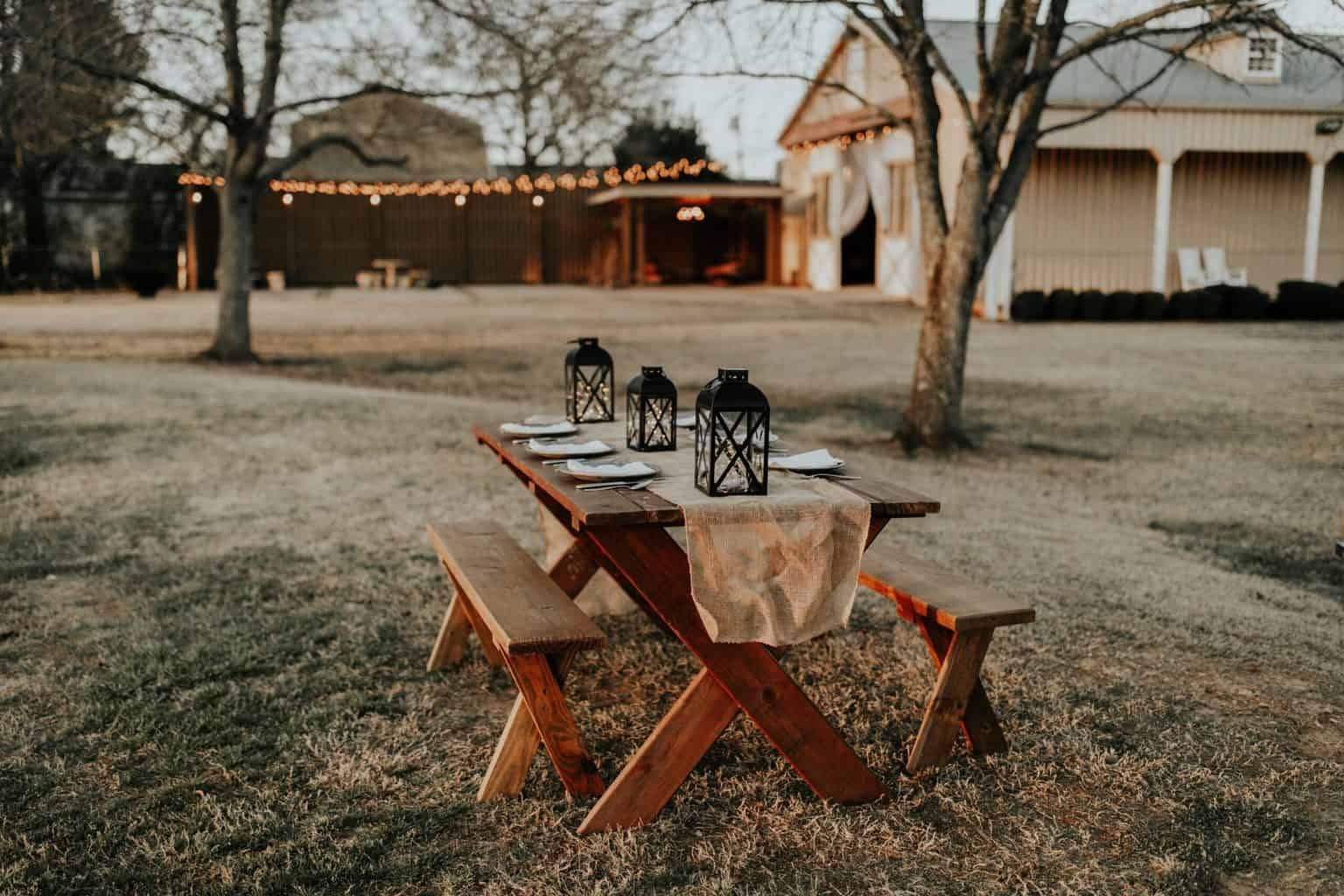 A picnic table outdoors with lamps