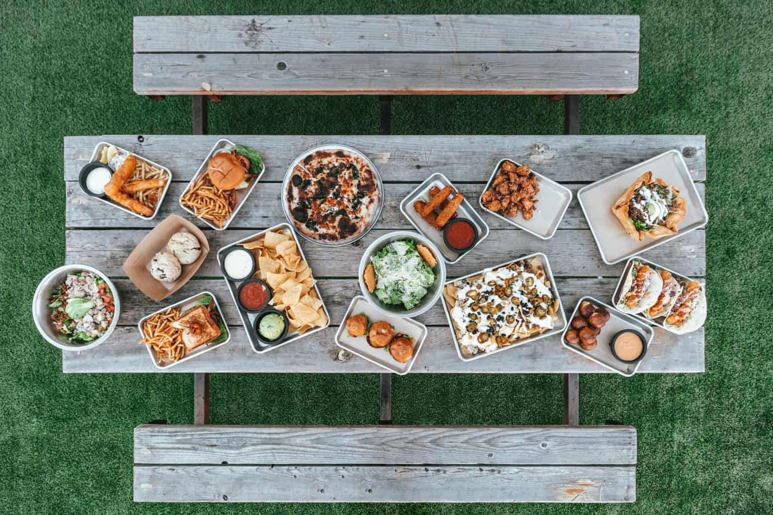 A top view of a picnic table with food