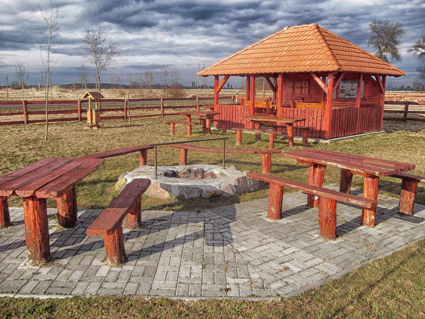 Two brown toned picnic tables
