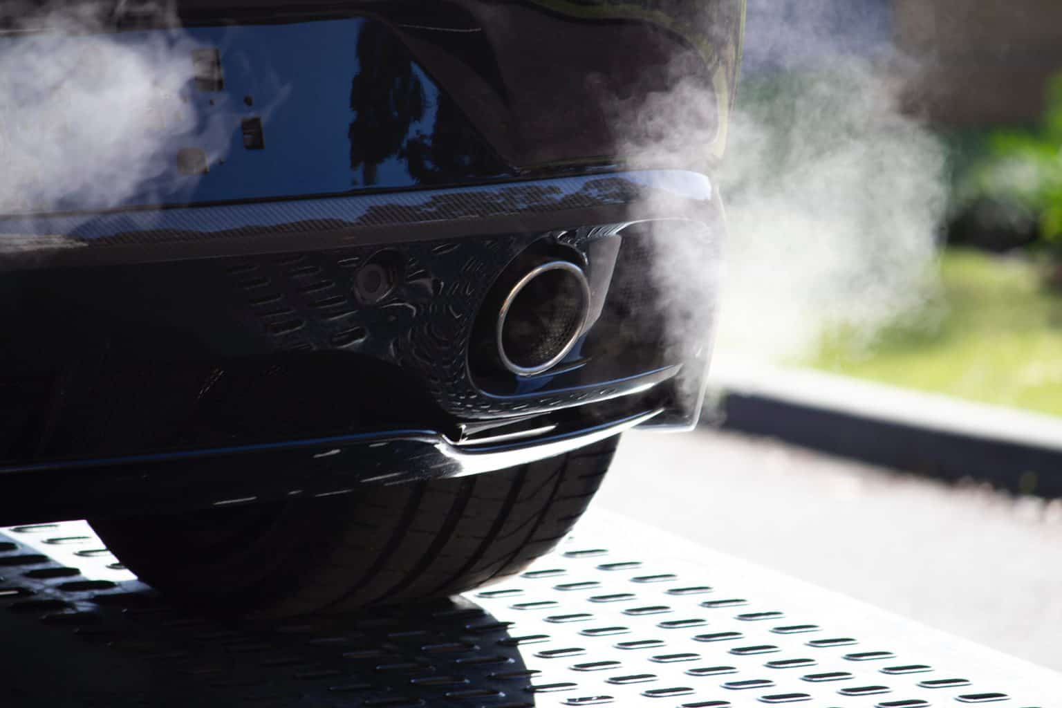 An exhaust of a car with smoke