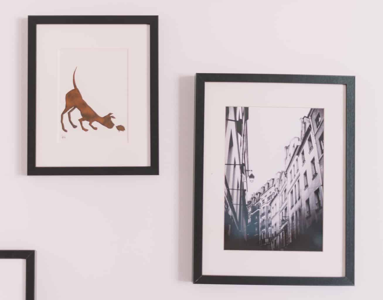 Two poster frames mounted on wall