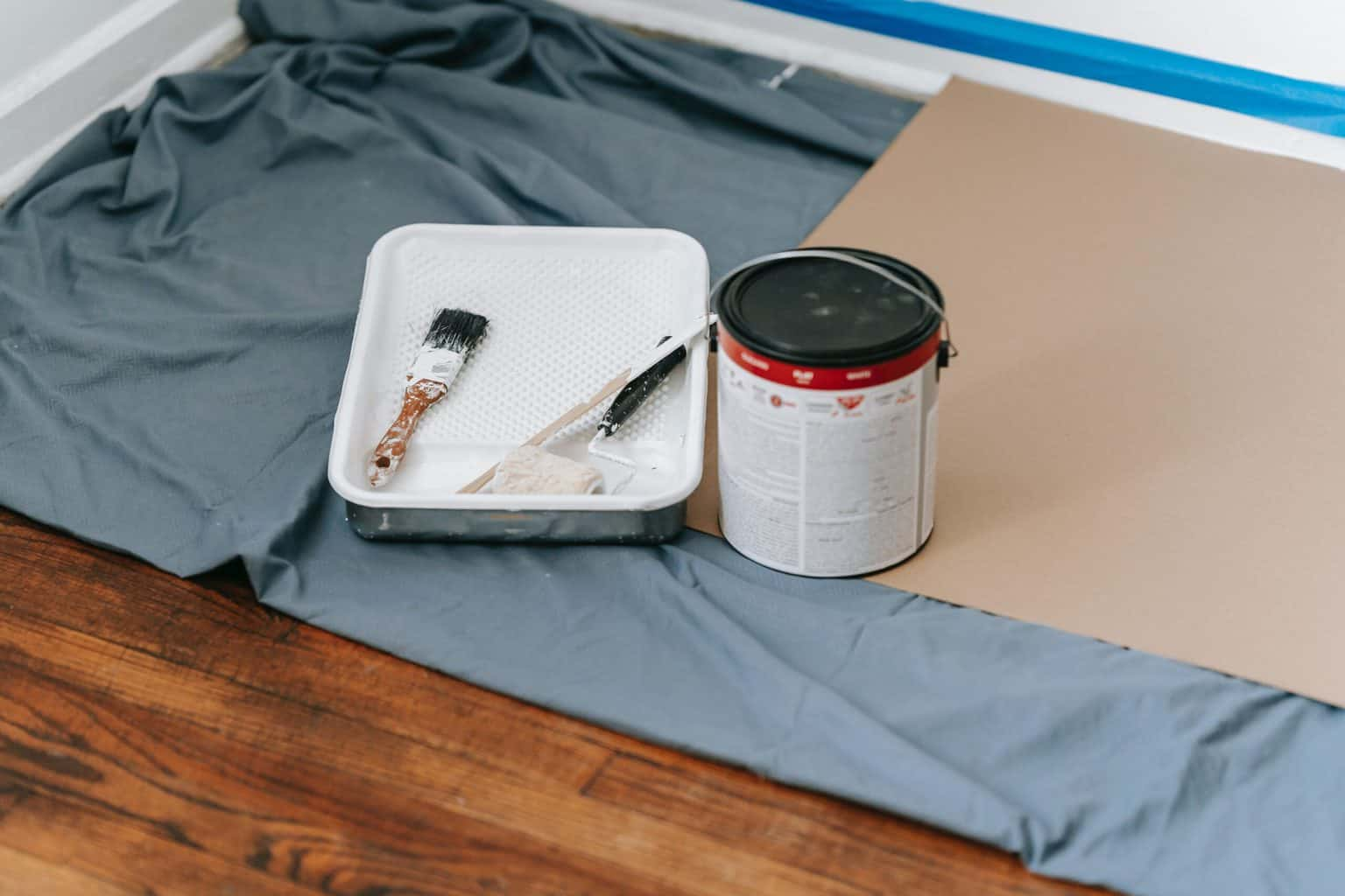 A paint can and paint brushes