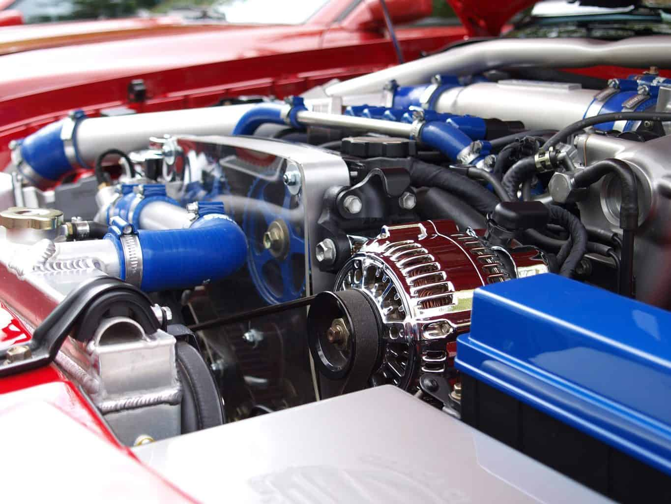 A car engine with blue toned pipes