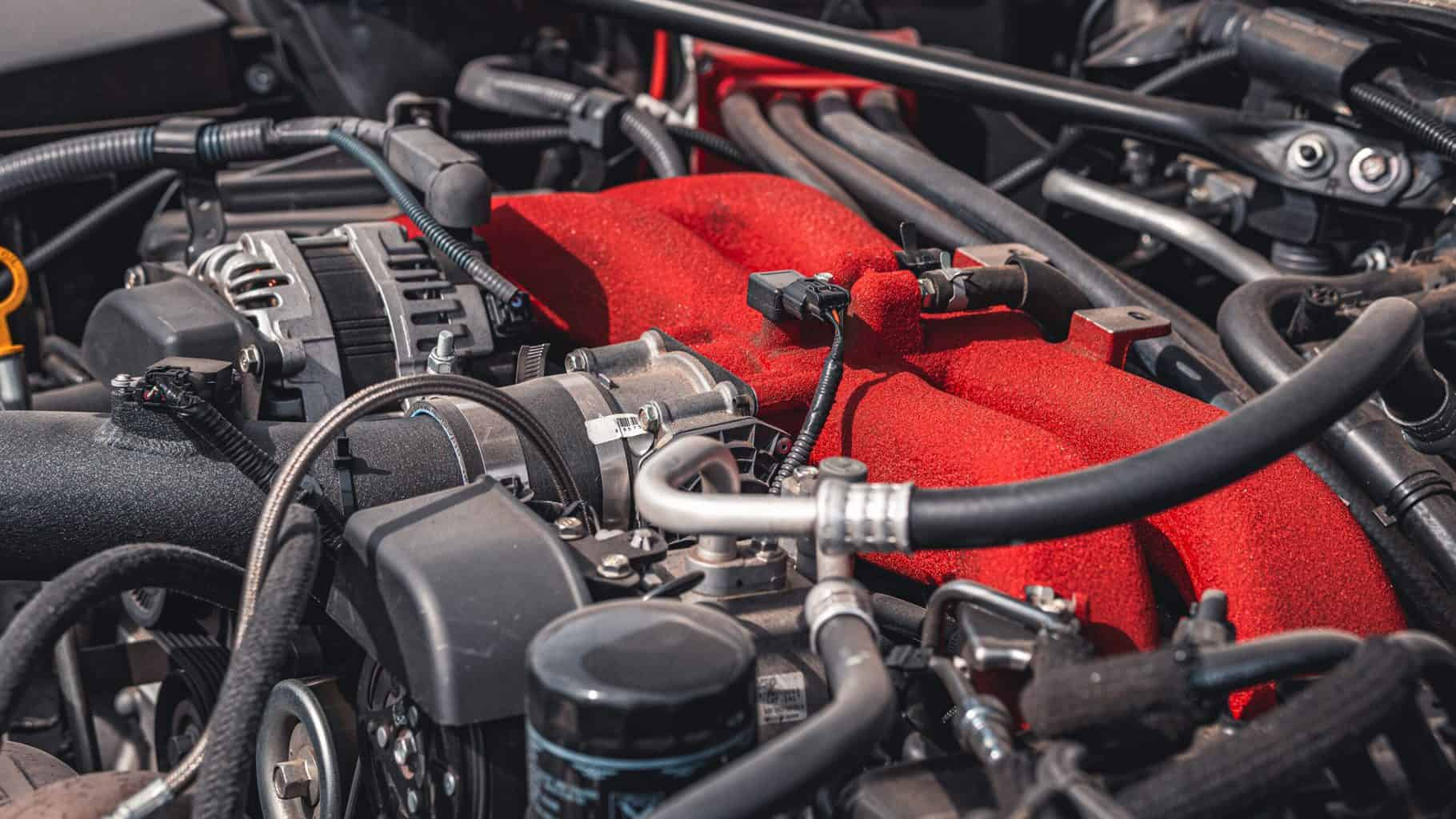 A car engine with a red block heater
