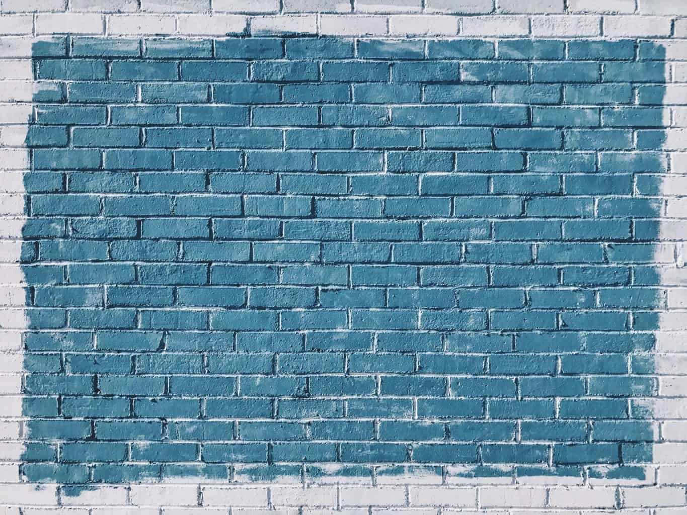 A white and blue toned brick wall