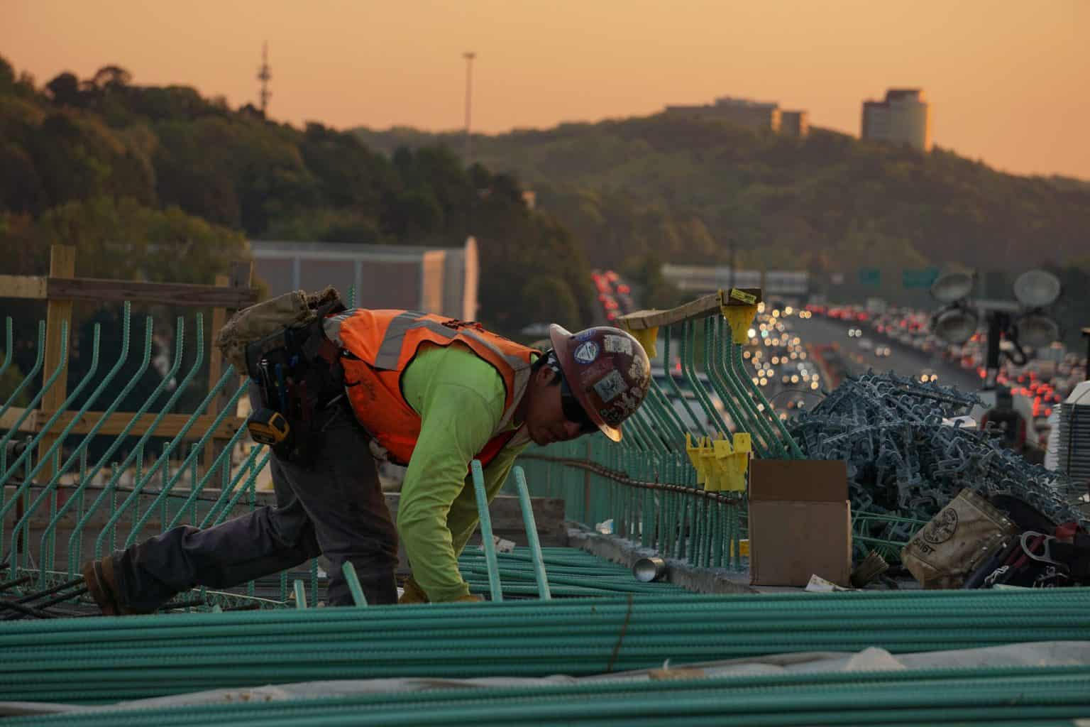 A construction worker working on the roof