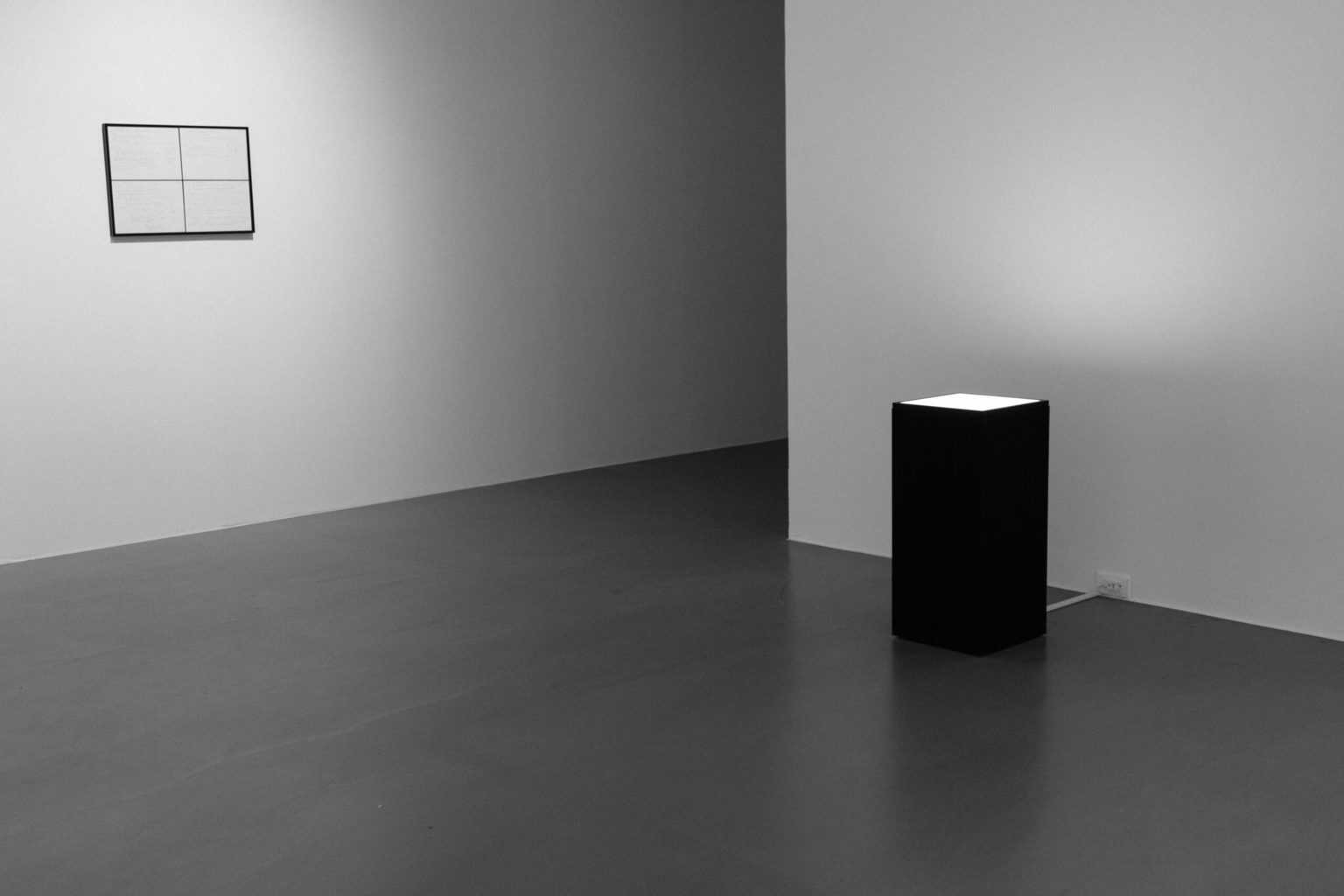 A black and white room with shiny and smooth floor