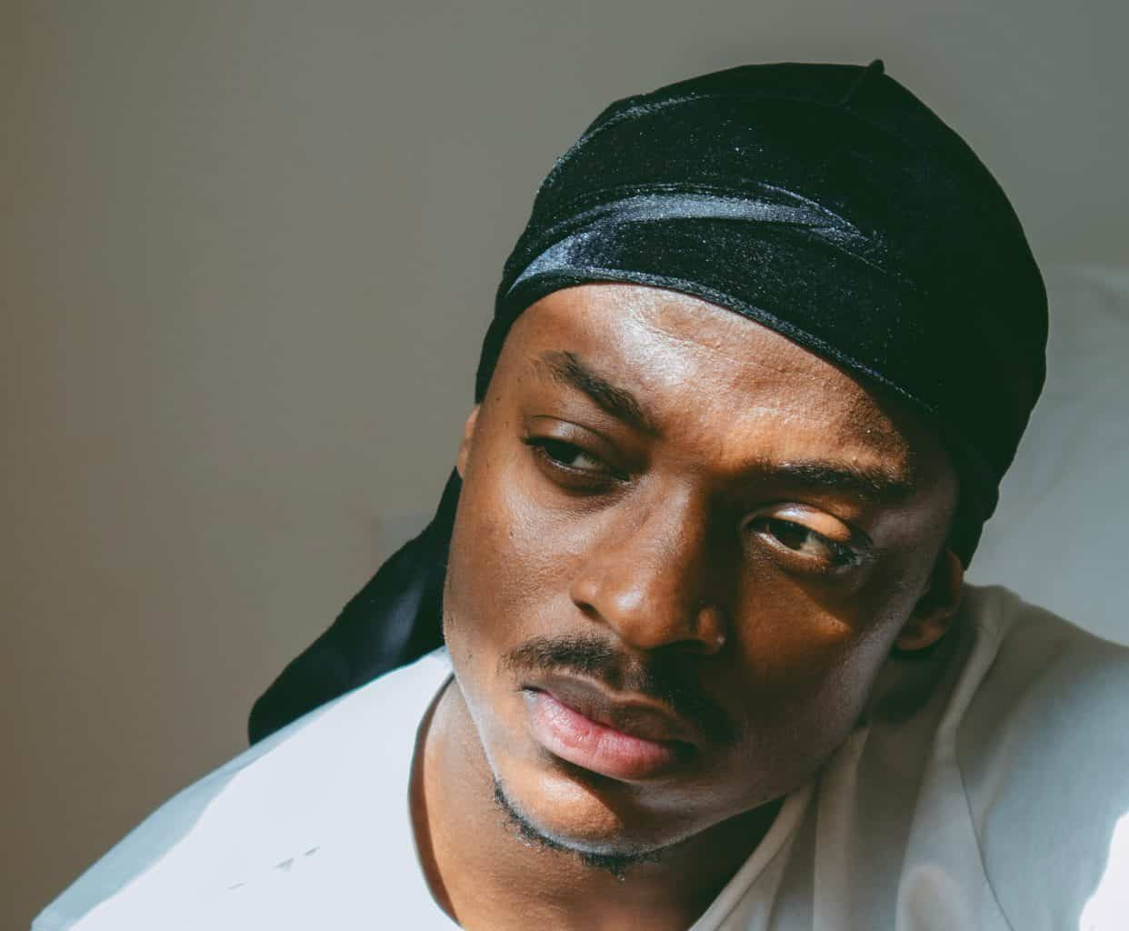 A man wearing a durag with sunlight