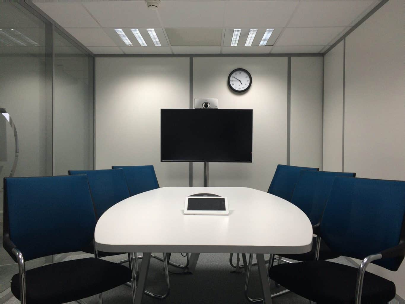 A conference room with chairs and a mounted tv