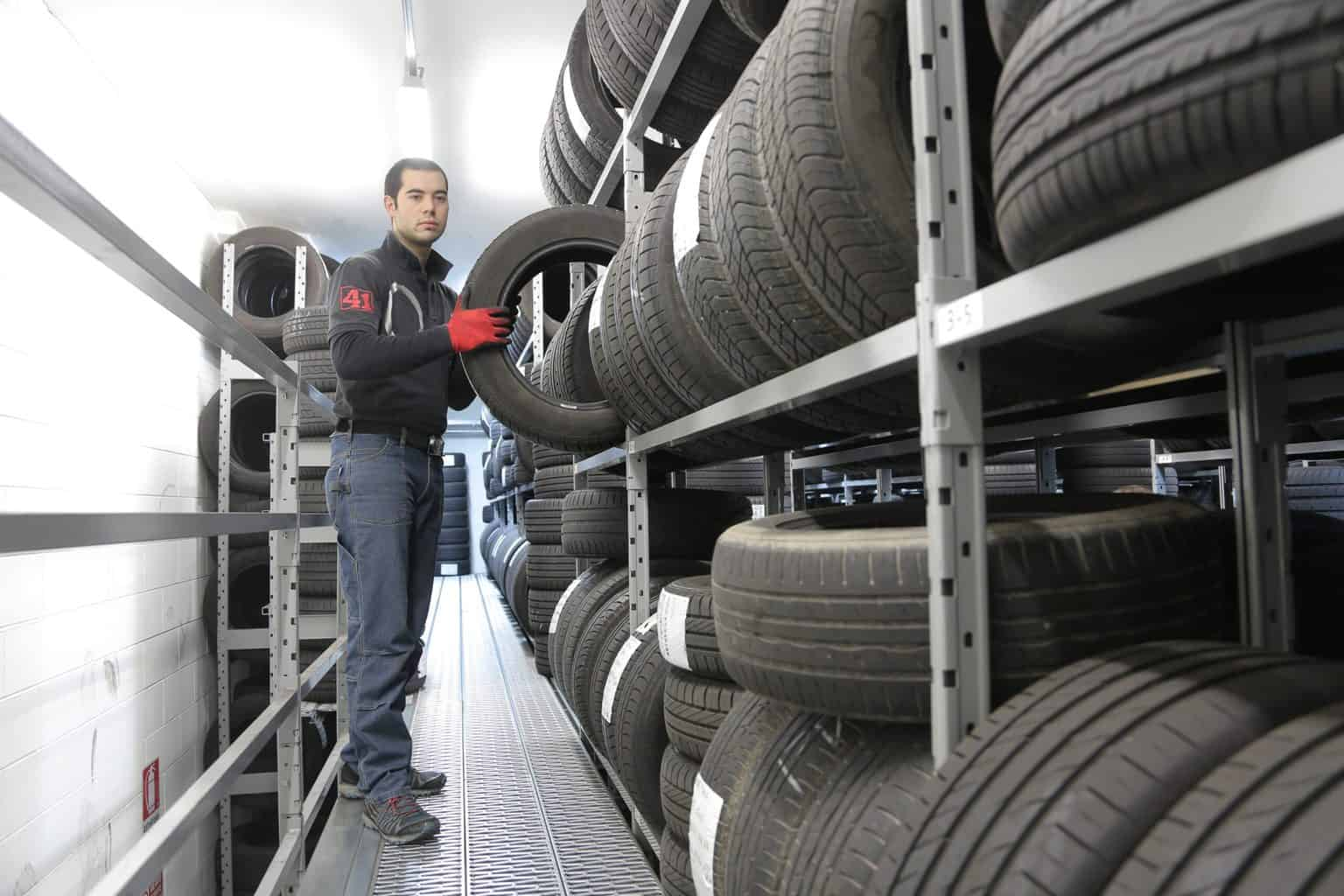 A man with a rack of tires