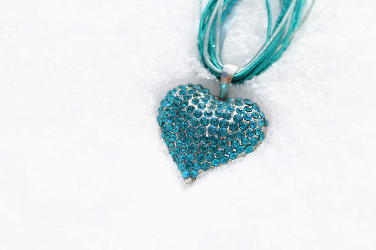 A A heart shaped jewelry with blue rhinestones