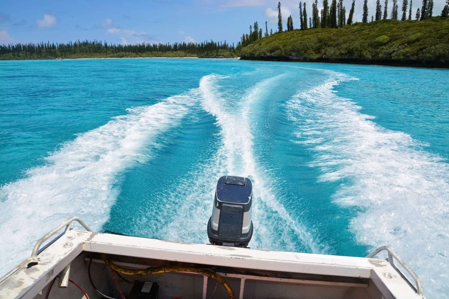 A rear shot of a moving boat with trolling motor