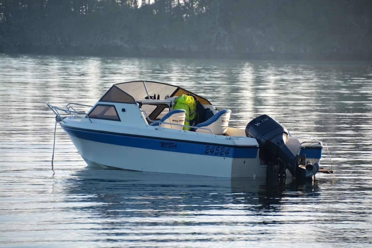 A boat in the middle of the water with a trolling motor