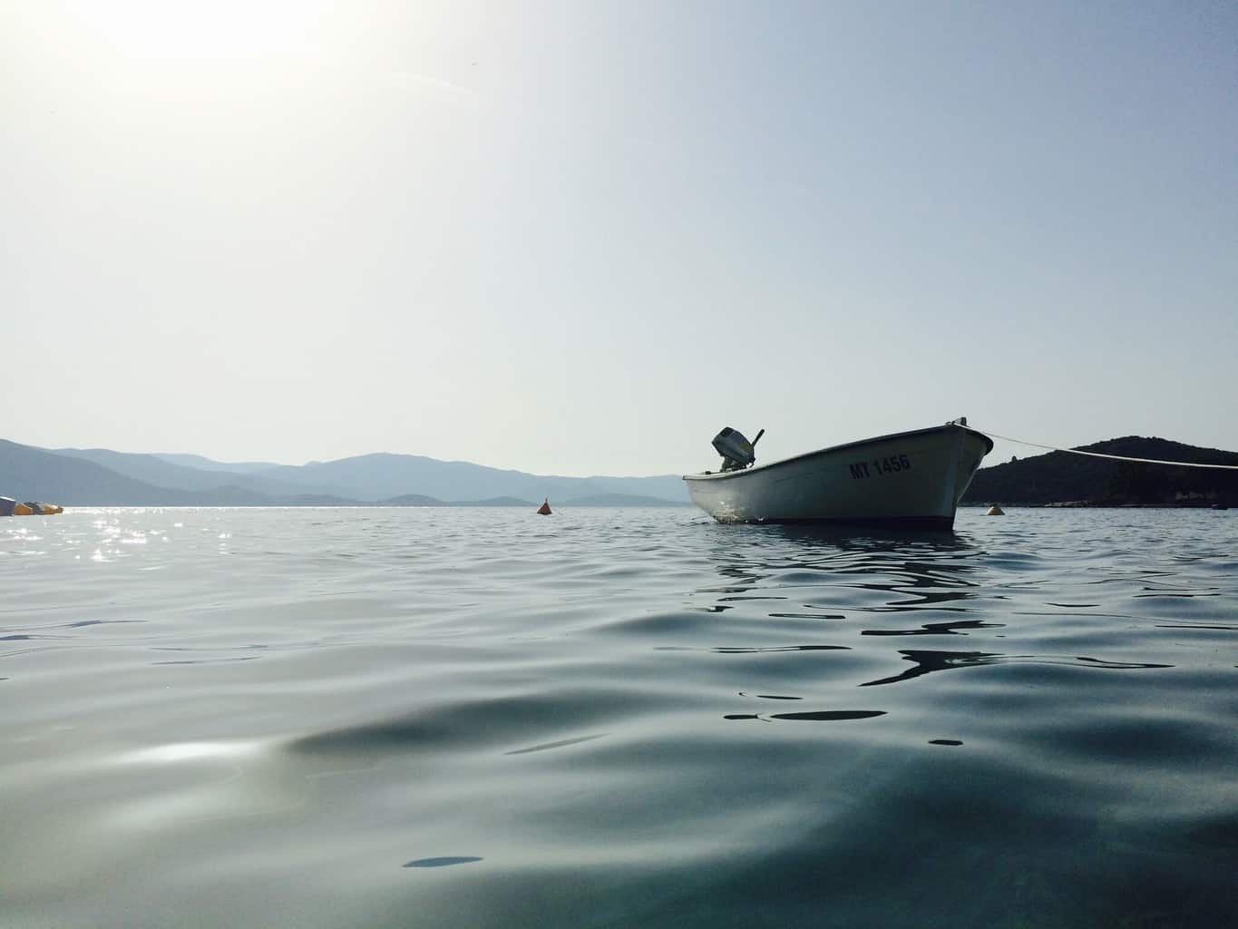 A worm view of a boat in the water with trolling motor