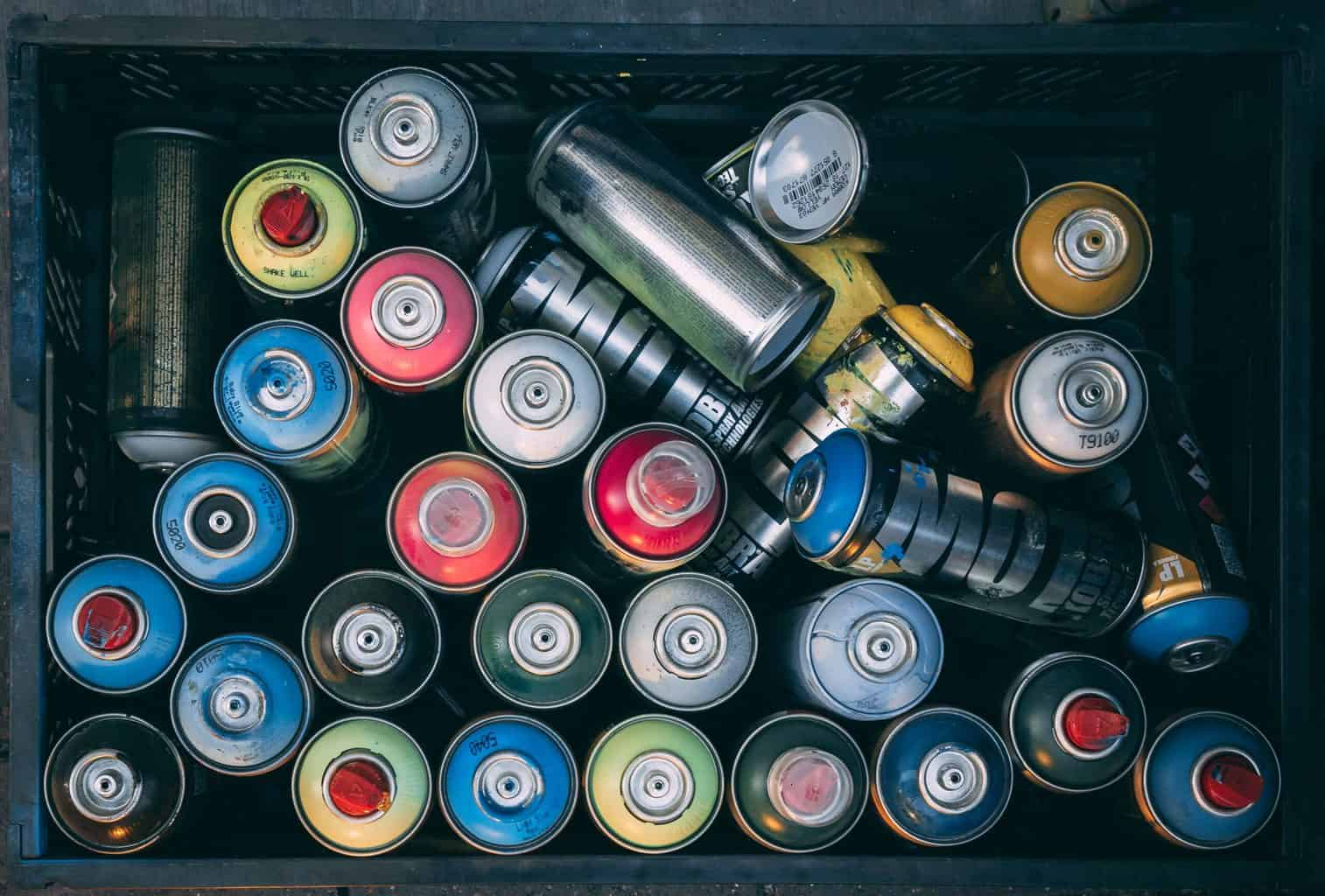 Top view of spray paint cans stacked togehter