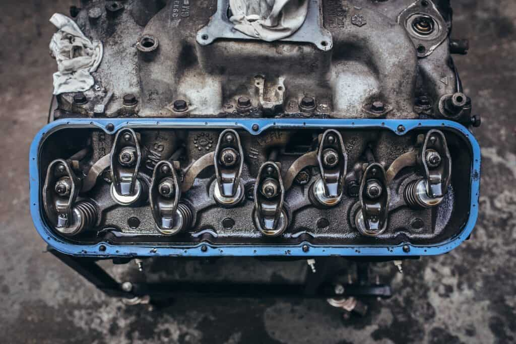 An oily engine block removed from the car