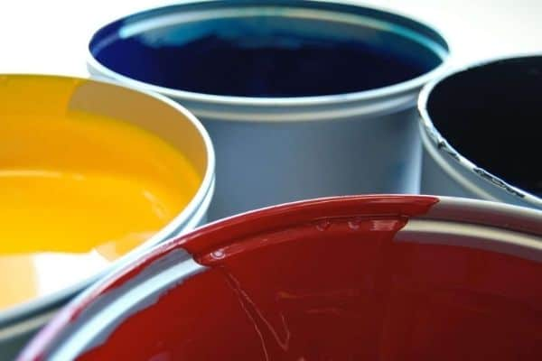 Buckets of paint with different colors