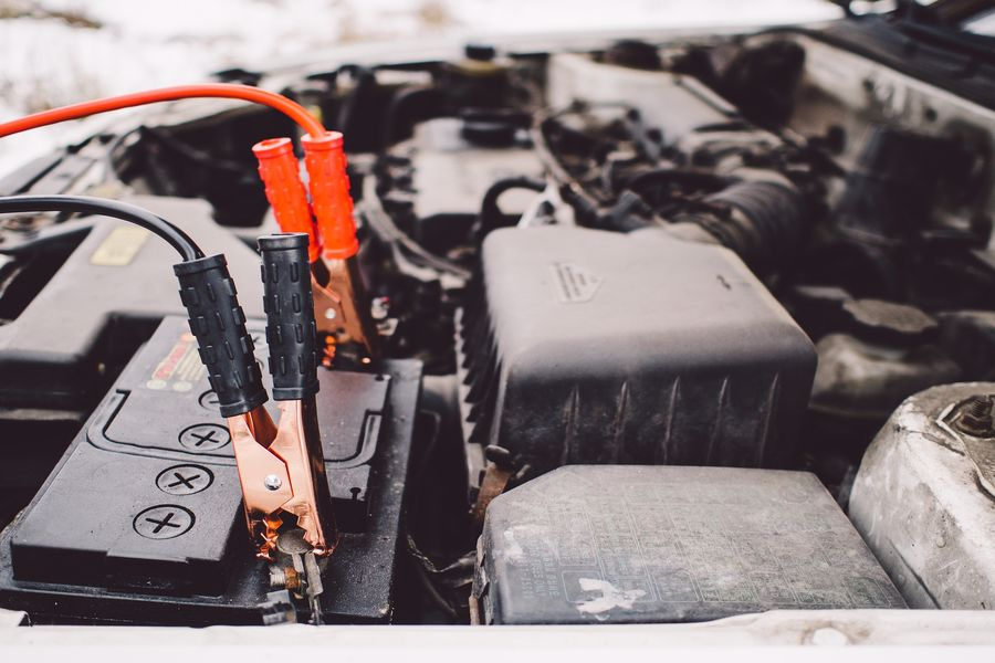 Jumper cables attached to the car battery